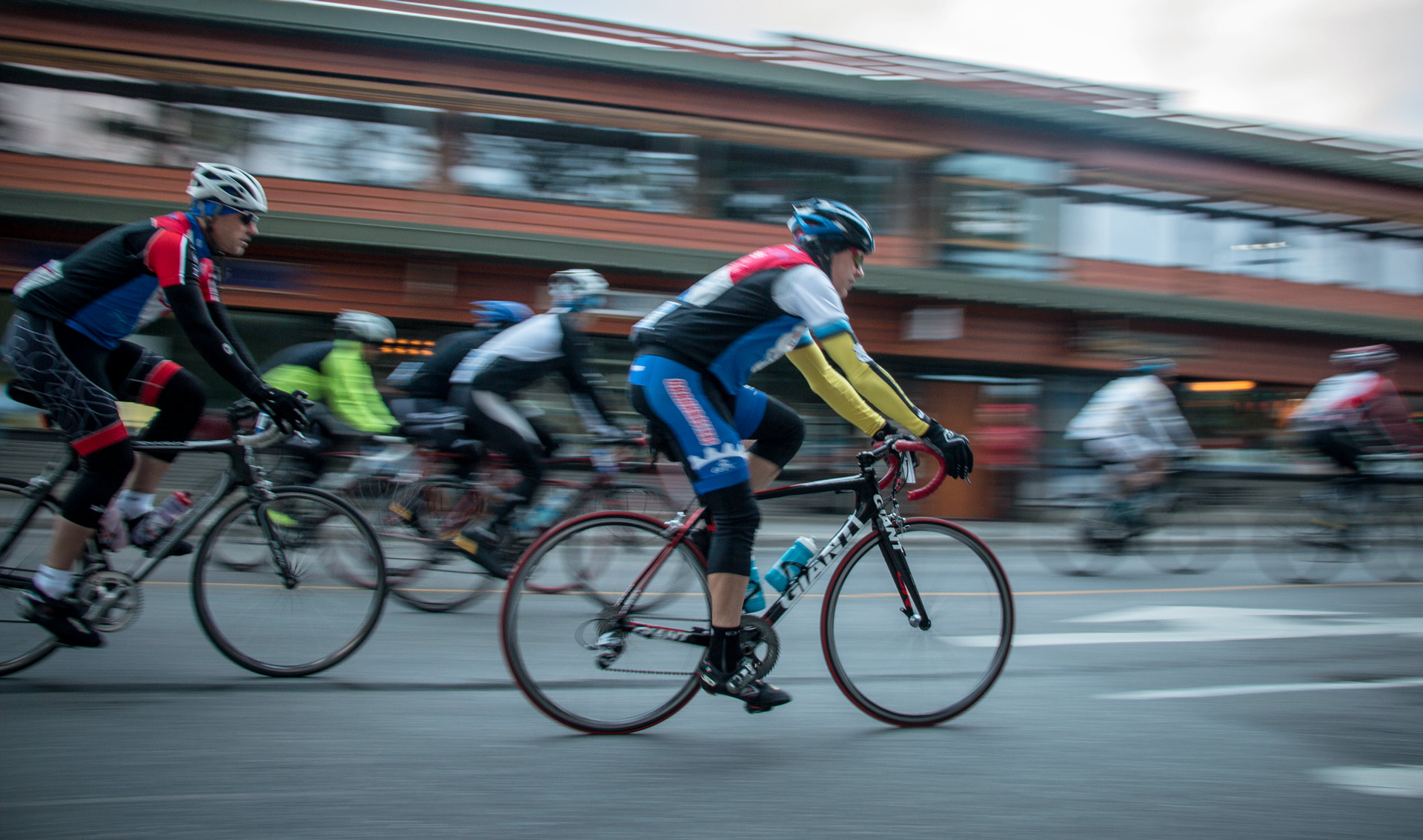 Bike race in full flow in downtown Banff. Gran Fondo is a 100 mile race that takes you in and around the scenic mountains of Banff.